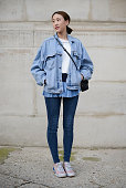 Ponthip Chaimuttayompol poses wearing a vintage outfit Zara bag and Puma shoes during day 3 of Paris Haute Couture Spring Summer 2015 on January 27...
