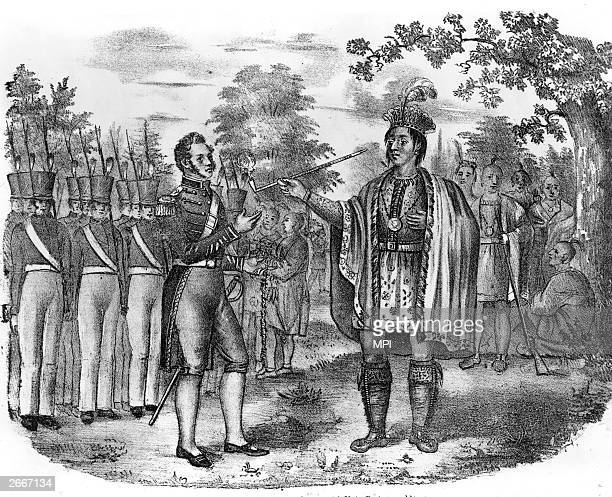 Pontiac chief of the Ottawa tribe and leader of a federation of Native Americans against the settlers smokes the peace pipe at a meeting with Major...