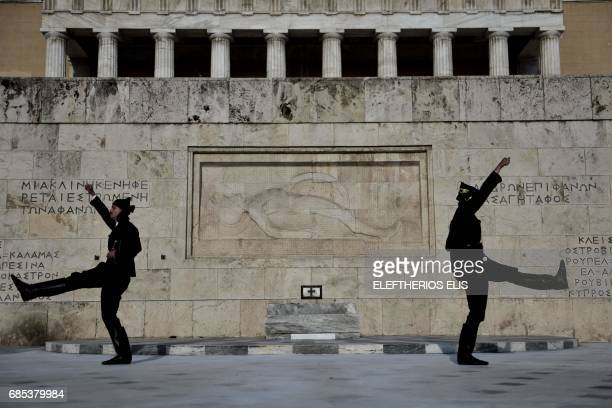 TOPSHOT Pontic Greek guards perform outside the Greek parliament on May 19 the day of remembrance of the Pontic Greek Genocide Pontic Greek who...