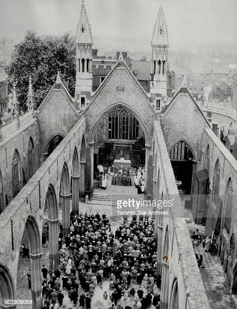 Pontifical Mass in the ruins of St George's Cathedral Southwark London is conducted to mark a Knights of Columbus anniversary War bombs left church...