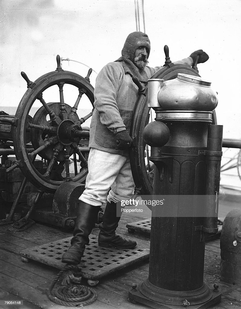 H,G Ponting, Captain Scott+s Antarctic Expedition 1910 - 1912, McCarthy grapples with the steering wheel on board the Terra Nova ship
