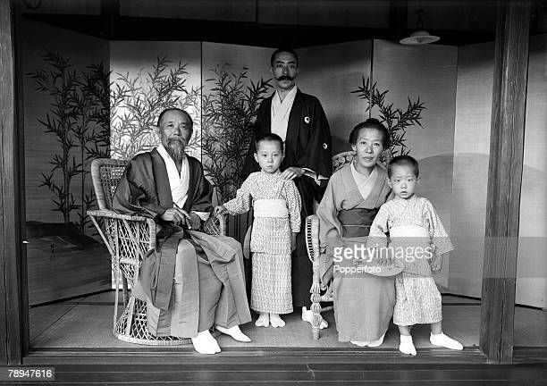 HG Ponting in Asia 1900 1906 Japan Marquis Hirobumi Ito his wife his son and his two grandsons pose for a family group photograph at his country...