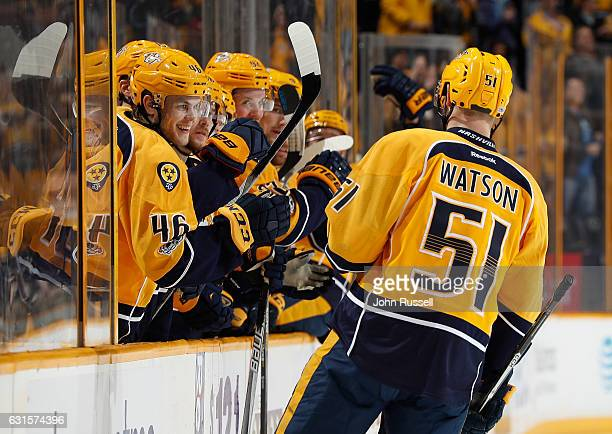 Pontus Aberg congratulates Austin Watson of the Nashville Predators on his goal against the Boston Bruins during an NHL game at Bridgestone Arena on...