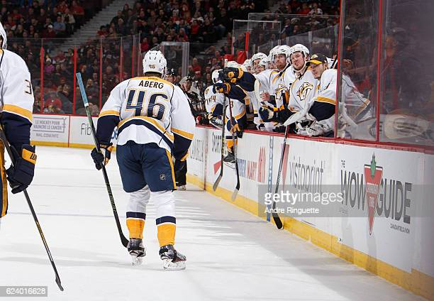 Pontus Aberg of the Nashville Predators celebrates his first career NHL goal in a game against the Ottawa Senators with teammates at the players...