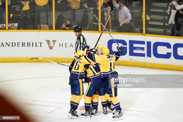 Pontus Aberg of the Nashville Predators celebrates with teammates after scoring a goal against the Anaheim Ducks during the third period in Game Six...