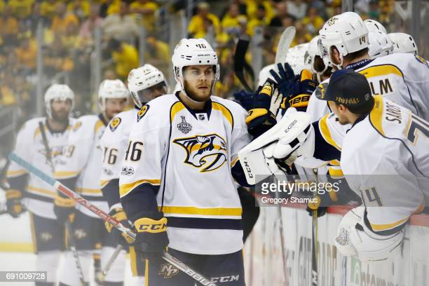 Pontus Aberg of the Nashville Predators celebrates with teammates on the bench after scoring a goal during the first period in Game Two of the 2017...