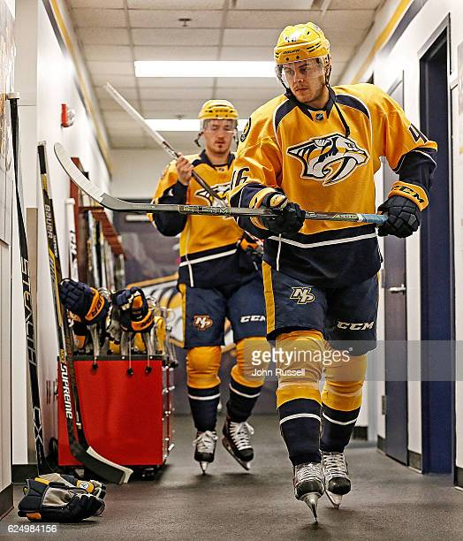 Pontus Aberg of the Nashville Predators checks his stick prior to warmups against the Tampa Bay Lightning during an NHL game at Bridgestone Arena on...