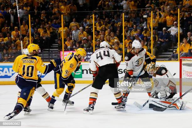 Pontus Aberg of the Nashville Predators scores a goal against the defense of Jonathan Bernier of the Anaheim Ducks during the third period in Game...