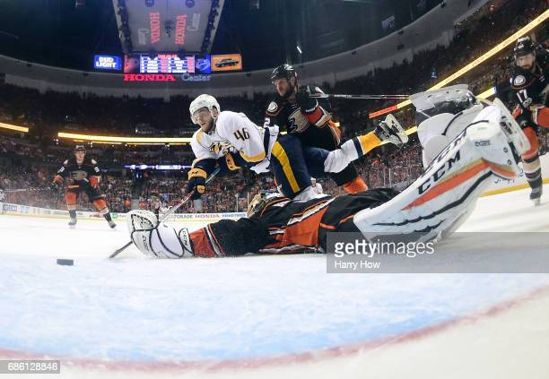 Pontus Aberg of the Nashville Predators scores a goal as he falls to the ice against goaltender Jonathan Bernier of the Anaheim Ducks in the third...