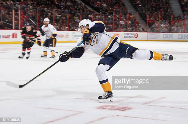 Pontus Aberg of the Nashville Predators scores his first career NHL goal on this shot in a game against the Ottawa Senators at Canadian Tire Centre...