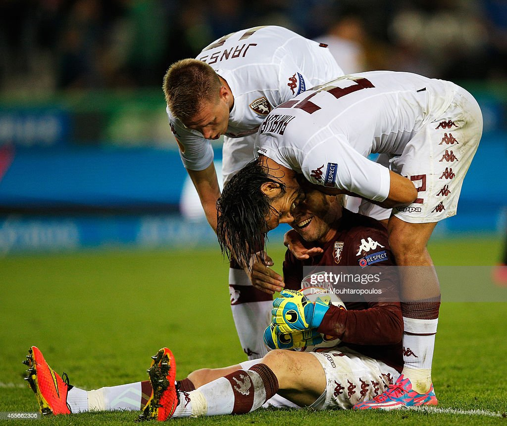 Pontus Jansson and <a gi-track='captionPersonalityLinkClicked' href=/galleries/search?phrase=Amauri+Carvalho+De+Oliveira&family=editorial&specificpeople=2089638 ng-click='$event.stopPropagation()'>Amauri Carvalho De Oliveira</a> congratulate their goalkeeper, Jean Francois Gillet of Torino after he makes a save in the final seconds of the match during the Group B UEFA Europa League match between Club Brugge KV and Torino FC at the Jan Breydelstadion on September 18, 2014 in Brussels, Belgium. The game finished 0-0.