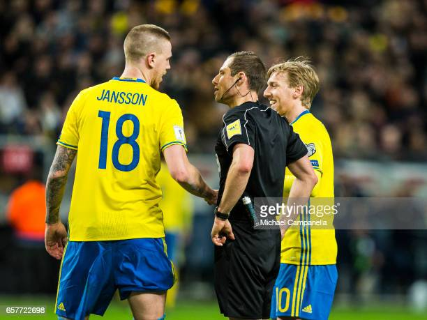 Pontus Jansson and Emil Forsberg of Sweden talk with referee Harald Lechner during the FIFA 2018 World Cup Qualifier between Sweden and Belarus at...