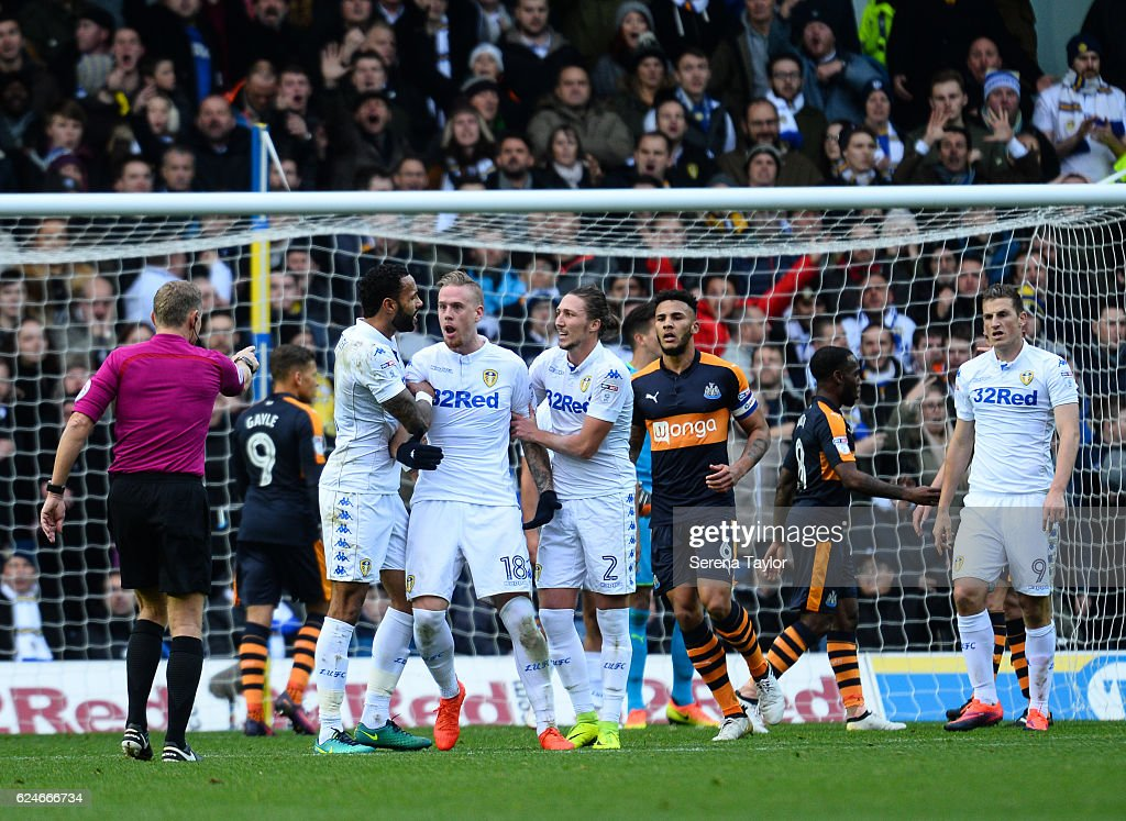Pontus Jansson of Leeds United (18) is held back by teammates Kyle Bartley of Leeds United (5) and Luke Ayling of Leeds United (2) after squaring up to Refereee Graham Scott after disagreeing with a decision during the Sky Bet Championship Match between Leeds United and Newcastle United at Elland Road on November 20, 2016 in London, England.
