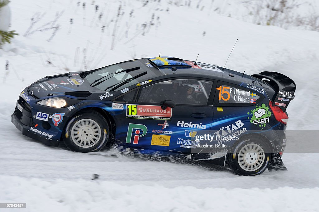 Pontus Tideman of Sweden and Ola Floene of Norway compete in their Ford Fiesta RS WRC during Day Two of the WRC Sweden on February 7 2014 in Karlstad...