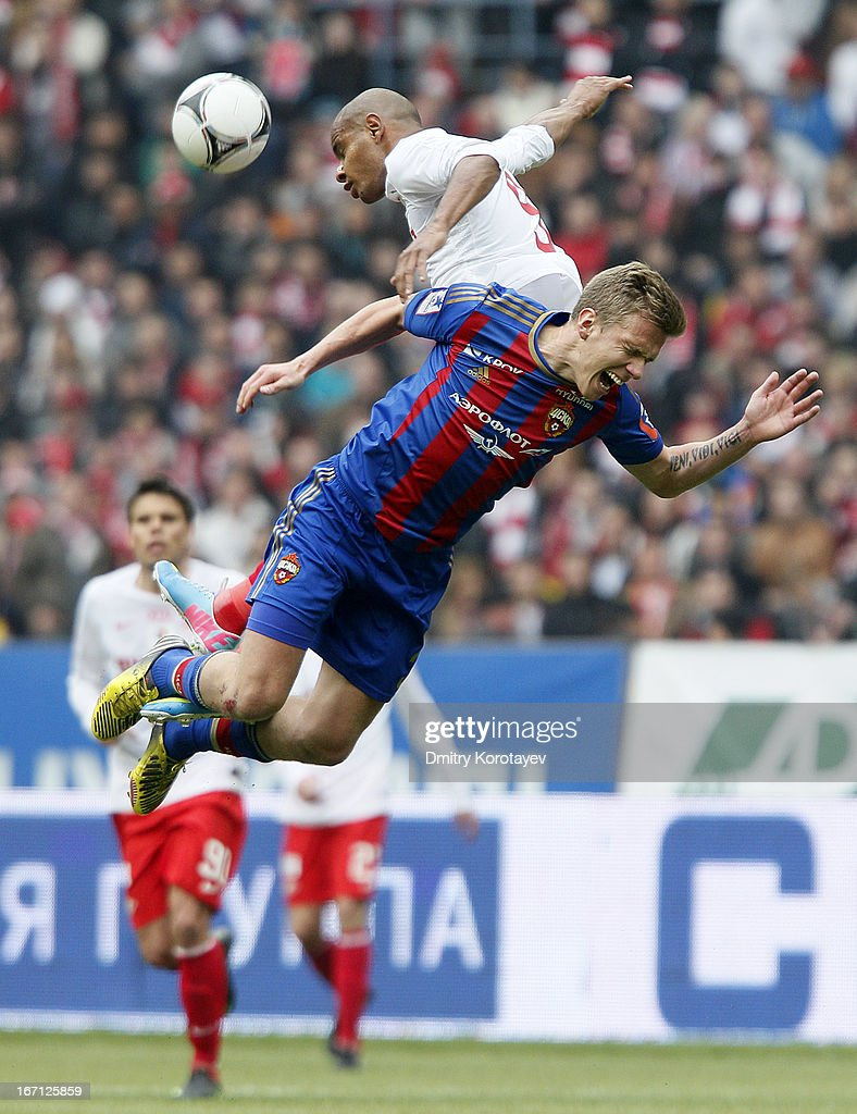 Pontus Wernbloom of PFC CSKA Moscow and Ari of FC Spartak Moscow jump for a header during the Russian Premier League match between PFC CSKA Moscow and FC Spartak Moscow at the Luzhniki Stadium on April 21, 2013 in Moscow, Russia.