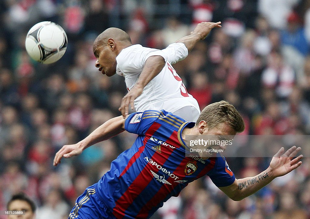 <a gi-track='captionPersonalityLinkClicked' href=/galleries/search?phrase=Pontus+Wernbloom&family=editorial&specificpeople=4835112 ng-click='$event.stopPropagation()'>Pontus Wernbloom</a> of PFC CSKA Moscow and Ari of FC Spartak Moscow jump for a header during the Russian Premier League match between PFC CSKA Moscow and FC Spartak Moscow at the Luzhniki Stadium on April 21, 2013 in Moscow, Russia.