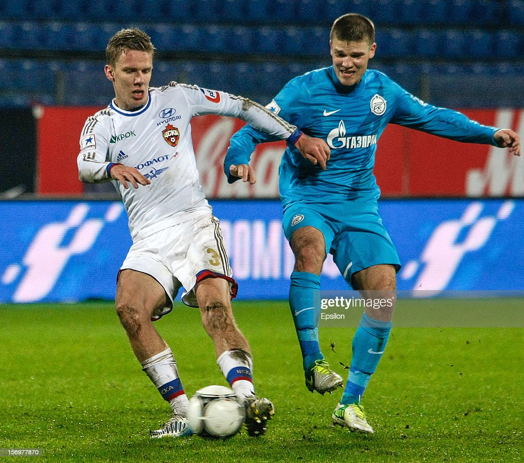 Pontus Wernbloom of PFC CSKA Moscow (L) and Igor Denisov of FC Zenit St. Petersburg vie for the ball during the Russian Football League Championship match between FC Zenit St. Petersburg and PFC CSKA Moscow at the Petrovsky Stadium on November 26, 2012 in St. Petersburg, Russia.