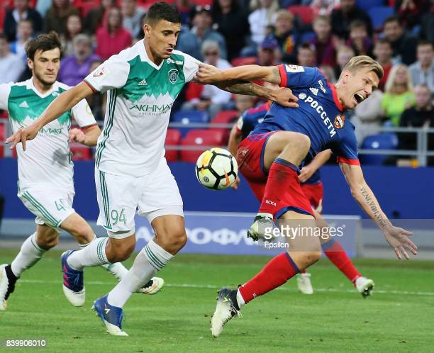 Pontus Wernbloom of PFC CSKA Moscow vies for the ball with Philipe Sampaio n of FC Akhmat Grozny during the Russian Premier League match between PFC...