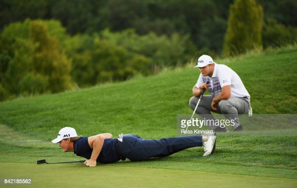 Pontus Widegren of Sweden and Jonathan Thomson of England assess a putt on the 10th green during the final round on day four of the DD REAL Czech...
