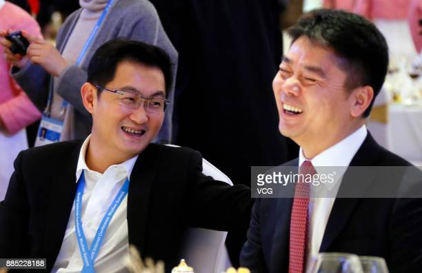 'Pony' Ma Huateng chairman and chief executive officer of Tencent Holdings Ltd chats with Chairman and CEO of JDcom Liu Qiangdong during the 4th...
