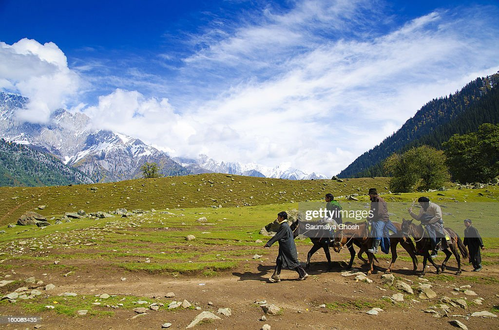 CONTENT] Ponywallahs are taking tourists to the Thajiwas glacier in Sonmarg valley. Three tourists are enjoying the pony ride in a pleasant weather.