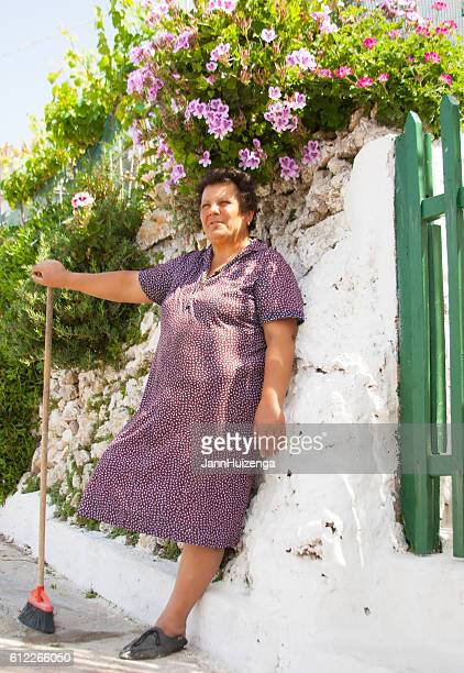Ponza, Italy: Woman with Broom, Whitewashed Wall, Flowers