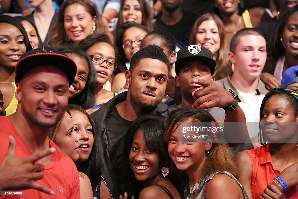 <a gi-track='captionPersonalityLinkClicked' href=/galleries/search?phrase=Pooch+Hall&family=editorial&specificpeople=879951 ng-click='$event.stopPropagation()'>Pooch Hall</a> (C) visits BET's 106 and Park at BET Studios on July 24, 2013 in New York City.