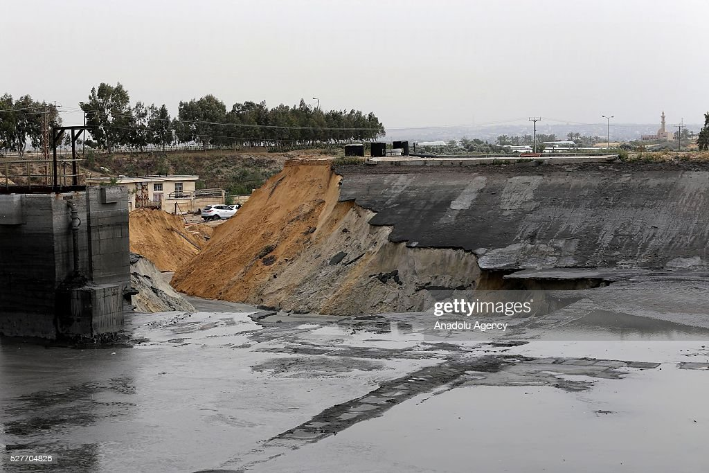 A pool belongs to waste water purification plant cracks up and causes damage on the area in Ez-Zeytun neighborhood of Gaza City, Gaza on May 3, 2016.