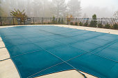 A Blue Vinyl Pool Cover in Fog