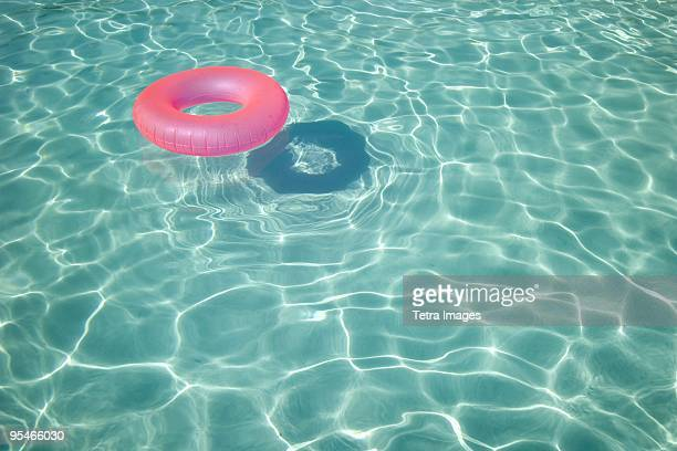 A pool donut floating in a swimming pool