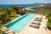 Pool, lounge chairs, gazebo overlooking beach