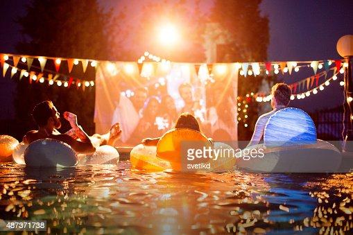 Pool movie night party.