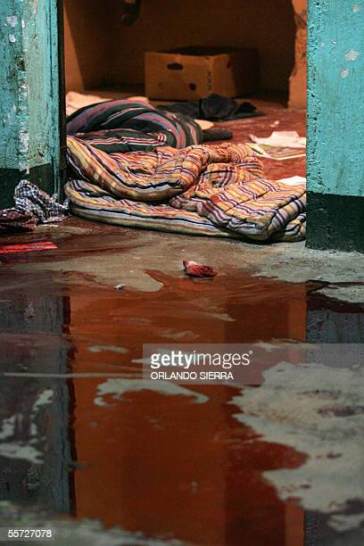 A pool of blood covers the floor where 12 members of the Mara 18 gang were killed in a clash with a rival gang at a youth rehabilitation center in...