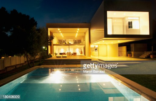 Pool outside modern house at night stock photo getty images for Modern house at night