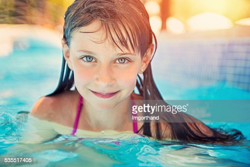 pool portrait of a pretty little girl stock photo getty. Black Bedroom Furniture Sets. Home Design Ideas
