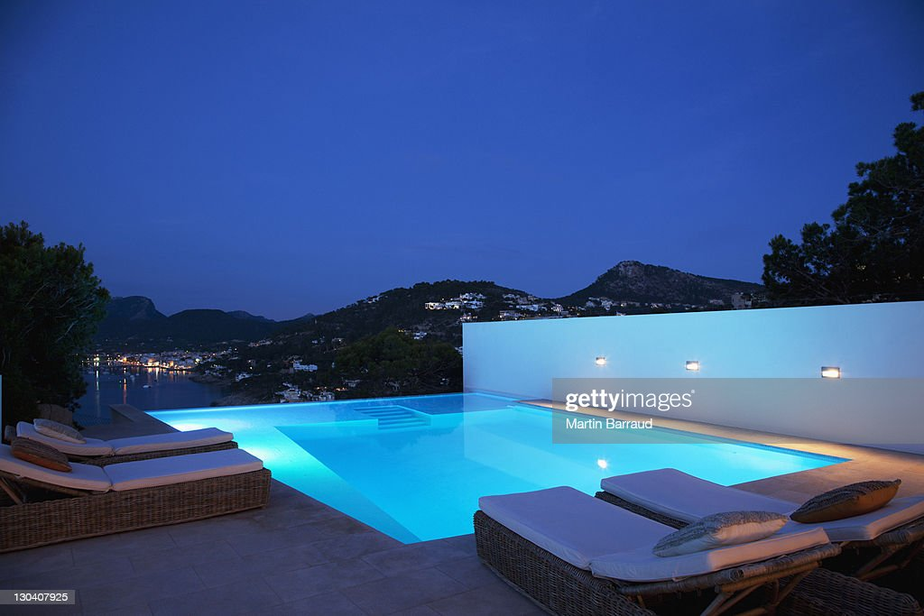 Pool with lounge chairs at night : Stock Photo