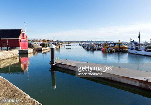 Poole harbour and quay Dorset England UK with boats : Stock Photo