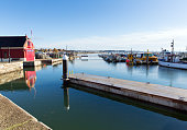 Poole harbour and quay Dorset England UK on a beautiful calm day with boats and blue sky