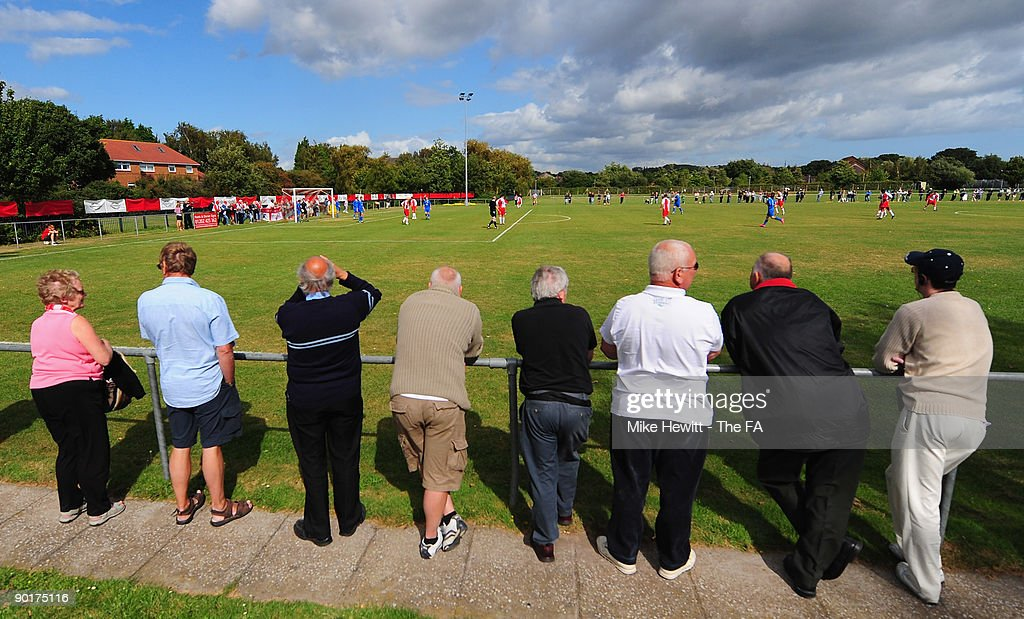 Poole Town fans spectate during the FA Cup Preliminary Round match between Poole Town and Barnstaple Town at Tatnum Ground on August 29 2009 in Poole...