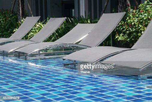 Poolside Bed poolside bed stock photo | thinkstock