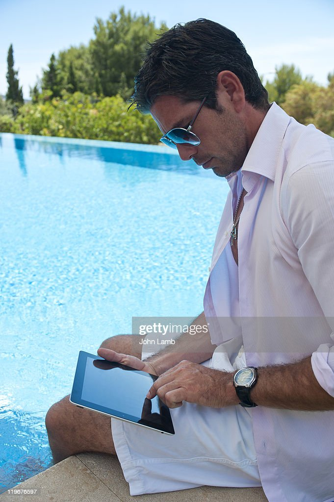 Poolside touchscreen : Stock Photo