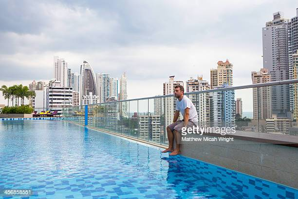 A poolside view over a city skyline