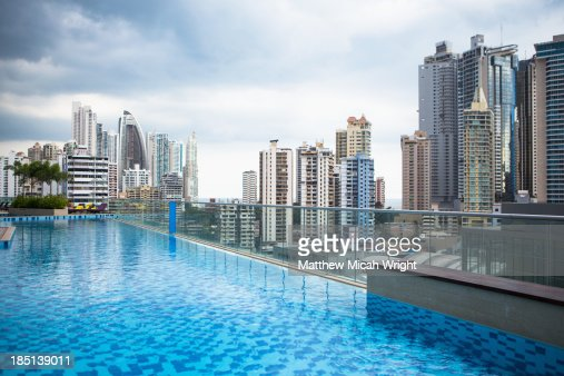 A poolside view overlooking the city skyline.