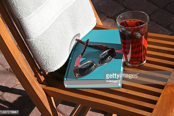 Poolside With Old Fashioned Book, Sunglasses and Drink