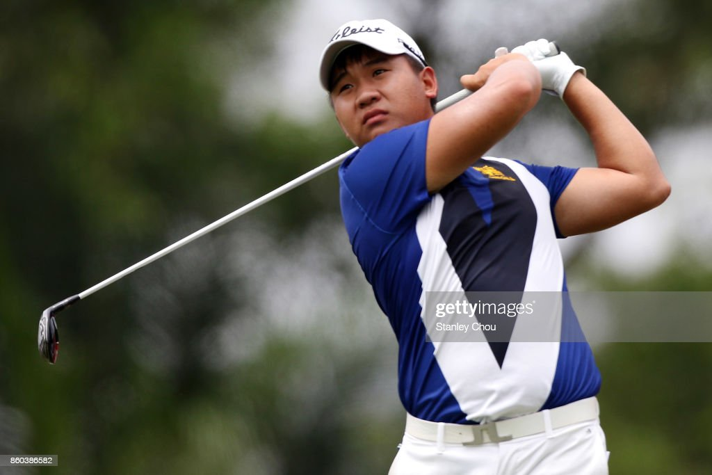 Poom Saksansin of Thailand plays his tee shot on the 12th hole during round one of the 2017 CIMB Classic at TPC Kuala Lumpur on October 12, 2017 in Kuala Lumpur, Malaysia.