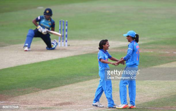 Poonam Yadav of India celebrates with Harmanpreet Kaur of India after bowling out Chamari Athapaththu of Sri Lanka during the ICC Women's World Cup...