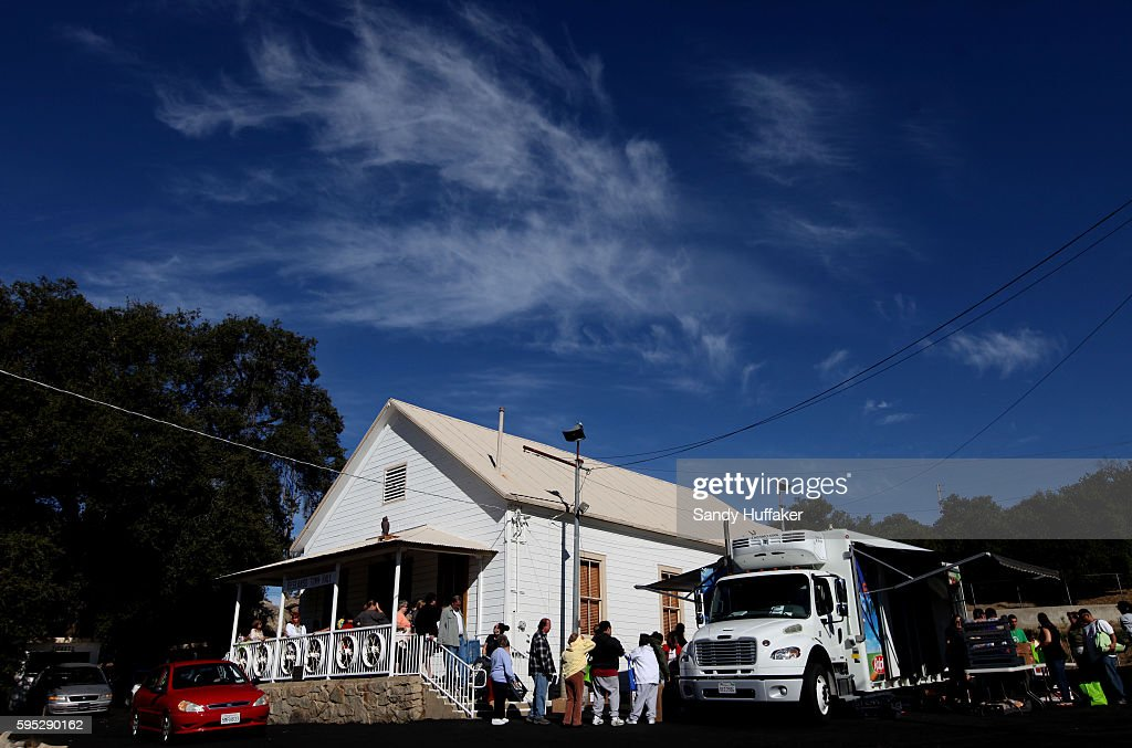 Poor and elderly residents receive donated food items from a Feeding America truck on Thursday November 3 2011 at the Descanso Town Hall in Descanso...