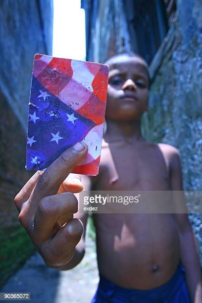 Poor boy showing american card