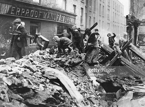 Poor children of Dublin collecting firewood from the ruined buildings damaged in the Easter Rising