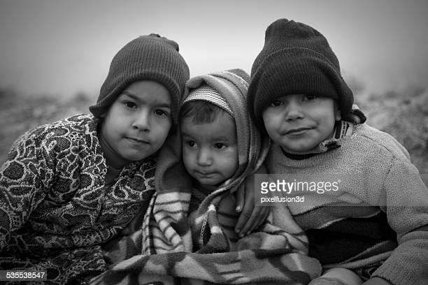 Poor Children Sitting in Winter Season